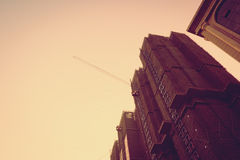Vintage filter : Looking up to construction building Royalty Free Stock Image