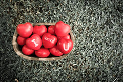 Vintage filter, A lot of heart in wood bucket with i love you  w Stock Photography