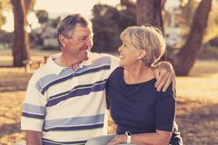Vintage filter portrait of American senior beautiful and happy mature couple around 70 years old showing love and affection smilin. Portrait of American senior stock images