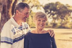 Vintage filter portrait of American senior beautiful and happy mature couple around 70 years old showing love and affection smilin. Portrait of American senior Royalty Free Stock Photos
