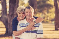 Vintage filter portrait of American senior beautiful and happy mature couple around 70 years old showing love and affection smilin. Portrait of American senior Stock Photos