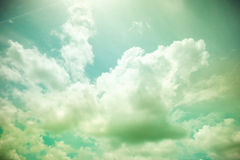 Vintage filter : Sun burst ray with cloudy and sky Royalty Free Stock Image