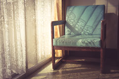 Vintage filtered armchair,interior concept. Royalty Free Stock Image