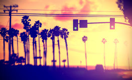 Vintage filtered blurred picture of street against sun. Stock Images