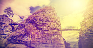 Vintage filtered bridges between rocks. Royalty Free Stock Photo