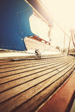 Vintage filtered close up picture of yacht deck and rigging. Stock Images
