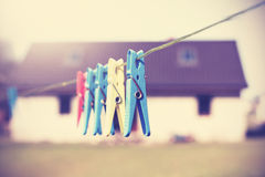 Vintage filtered clothespins hanging on a cord. Royalty Free Stock Images