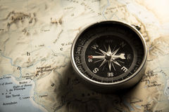 Vintage filtered of compass with map. Stock Photo