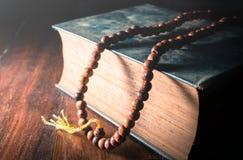 Vintage filtered of Necklace on book,religion background. Vintage color filtered of Necklace on book,religion background royalty free stock images