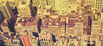 Vintage filtered panoramic view of Manhattan roofs. Stock Images