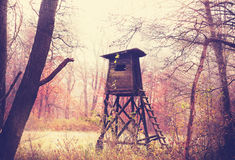 Vintage filtered photo of hunting pulpit in forest. Stock Photos