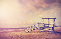 Vintage filtered picture of lifeguard tower, California, USA. Vintage filtered picture of wooden lifeguard tower at sunset, beach in California, USA royalty free stock image