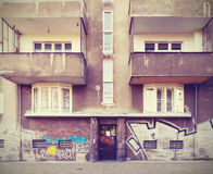 Vintage filtered picture of neglected tenement house. Royalty Free Stock Image