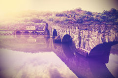 Vintage filtered picture of old bridge in Tuscany Stock Photo