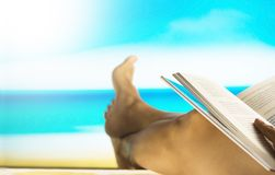 Vintage filtered: reading book at the beach royalty free stock photo