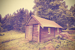 Vintage filtered wooden hut in forest. Stock Images