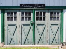 Vintage Finds Sign Above Old Country Barn Doors Stock Image