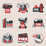 Vintage Fire Protection Logos Set. Of firefighting tools equipment and elements isolated vector illustration Stock Photos