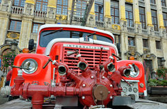 Vintage fire truck. BRUSSELS, BELGIUM-OCTOBER 18, 2014: Vintage fire truck exposed on Grand Place during 75 Anniversary of Royal Union Of Belgian Professional stock image