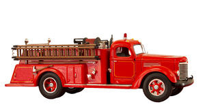 Vintage fire truck. Vintage red fire truck on a white background Stock Photos