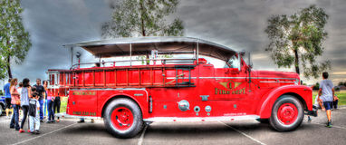 Vintage fire truck. Vintage red fire truck with wooden ladder on display at car show in Melbourne, Australia Stock Photo