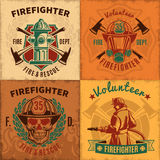 Vintage Firefighting Emblems Set. With fireman skull helmet mask hydrant and crossed axes vector illustration Royalty Free Stock Photo