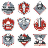 Vintage Firefighting Labels Set. With fireman truck and rescue equipment in red and gray colors  vector illustration Royalty Free Stock Photo