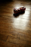Vintage firetruck model toy. On parquet floor stock photography