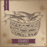 Vintage fish basket sketch. Placed on old paper background. Great for markets, grocery stores, organic shops, fishing and food label design Royalty Free Stock Photos