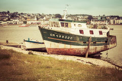 Vintage Fishing Boat. Old abandoned vintage fishing boat moored on the beach in France stock images