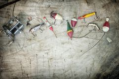 Vintage fishing tackle on an old wood background Stock Photos