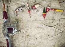 Vintage fishing tackle on an old wood background Royalty Free Stock Photo