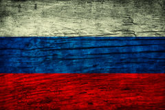 Vintage flag of the Russian Federation. On wooden surface Stock Photo