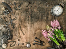 Vintage flat lay hyacinth flowers Old keys clock scissors Royalty Free Stock Image