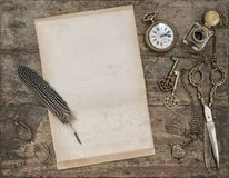 Vintage flat lay Letter paper antoque writing tools. Vintage flat lay. Letter paper and antoque writing tools. Feather pen, inkwell, keys Royalty Free Stock Photo