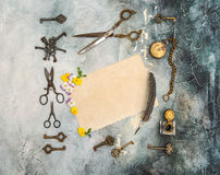 Vintage flat lay used paper sheet pansy flowers antique objects Royalty Free Stock Photography