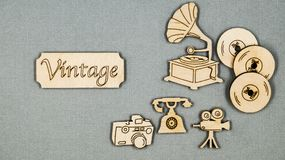 Vintage flat wooden things folded on a grey table. Telephone, phonograph, movie cameras, vinyl records and camera. Photo Royalty Free Stock Photography