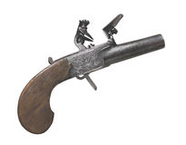 Vintage flintlock pocket pistol isolated Stock Images