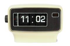 Vintage flip clock. Vintage flip alarm clock on white background royalty free stock photo