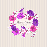 Vintage floral frame of petunias. Vector. Circlet of flowers on a striped beige background. Pink, purple and two-color petunia flowers and buds. Vector Royalty Free Stock Photography