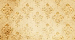 Old yellowed paper background with floral pattern. Royalty Free Stock Photo