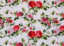 Vintage Floral textile pattern. Fragment of colorful retro tapestry textile pattern with floral ornament useful as background Royalty Free Stock Images