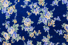 Vintage Floral textile pattern. Fragment of colorful retro tapestry textile pattern with floral ornament useful as background Royalty Free Stock Photos