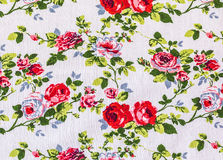 Vintage Floral textile pattern. Fragment of colorful retro tapestry textile pattern with floral ornament useful as background Royalty Free Stock Photography