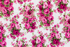 Vintage Floral textile pattern. Fragment of colorful retro tapestry textile pattern with floral ornament useful as background Royalty Free Stock Photo