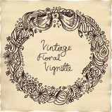 Vintage floral vignette. Ink-like drawing of floral vignette on parchment Stock Photography
