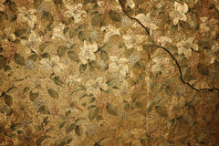 Vintage floral wallpaper. On cracked wall stock image