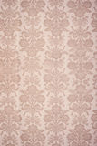 Vintage Floral Wallpaper. Vintage beige coloured floral wallpaper background with bouquets of flowers in rows Stock Photos