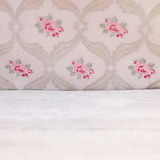 Vintage floral wallpaper with roses. Above a white textured area with copyspace for your text or advertising royalty free stock photos