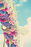 Vintage flower arch with dahlias, cloves and roses Stock Photos